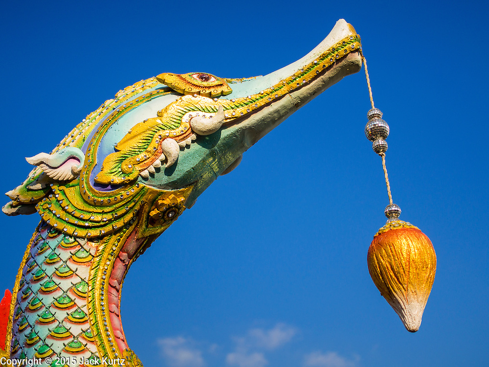 """31 MARCH 2015 - BANGKOK, THAILAND: A naga, or mythical serpent, on a float that will be in a parade for Princess Maha Chakri Sirindhorn, born 2 April 1955, the second daughter of King Bhumibol Adulyadej. Thais commonly refer to her by reducing such title to """"Phra Thep"""", meaning """"princess angel"""". Her title in Thai is the female equivalent of the title held by her brother, Crown Prince Maha Vajiralongkorn. The Thai constitution was altered in 1974 to allow for female succession, thus making her eligible for the throne.   PHOTO BY JACK KURTZ"""