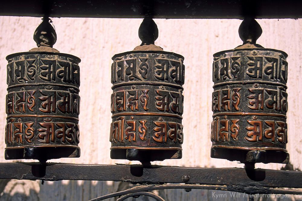 """Asia, Nepal, Kathmandu. Buddhist prayer wheels at Swayambhunath """"Monkey"""" Temple."""