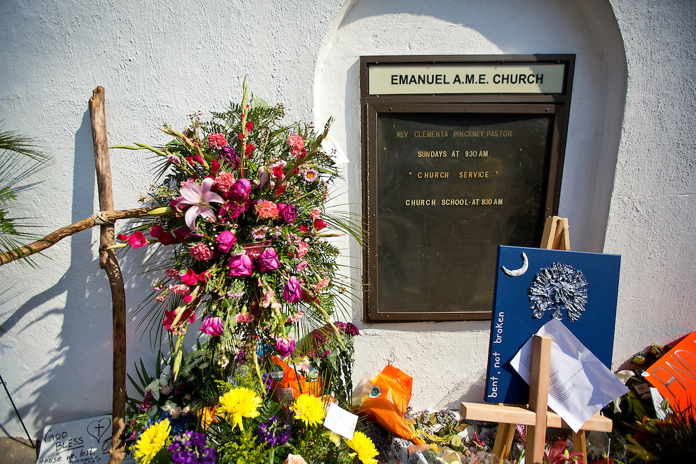 Flowers and a wooden cross placed outside of the Emanuel AME Church in Charleston, South Carolina after the shooting death of nine people.