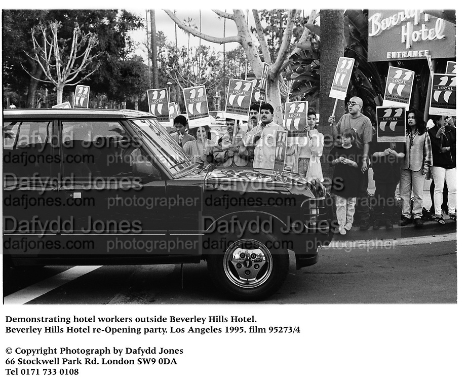 Demonstrating hotel workers outside Beverley Hills Hotel. Beverley Hills Hotel re-Opening party. Los Angeles 1995. Film 95273/4 <br />