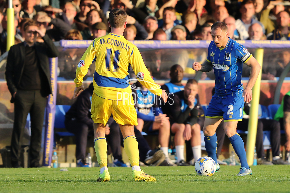 Barry Fuller (Captain) defender for AFC Wimbledon (2) and Sean McConville midfielder Accrington Stanley (11) during  the Sky Bet League 2 Play-Off first leg match between AFC Wimbledon and Accrington Stanley at the Cherry Red Records Stadium, Kingston, England on 14 May 2016. Photo by Stuart Butcher.