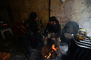 Aleppo, Syria, January, 2013 - Free Syrian Army fighters keep themselves warm at a checkpoint along Sabe'a Bhrat Street in the Old City section of Aleppo. (Photo by Miguel Juárez Lugo)