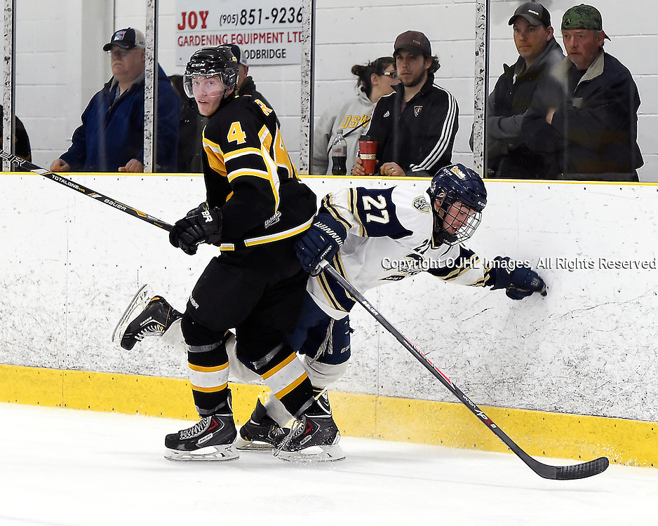TORONTO, ON - Apr 13 : Ontario Junior Hockey League, Buckland Cup Championship Series between the Aurora Tigers and the Toronto Lakeshore Patriots, Callum Fryer #4 of the Aurora Tigers makes the hit on Kevin Shier #27 of the Toronto Lakeshore Patriots during third period game action.<br /> (Photo by Andy Corneau / OJHL Images)