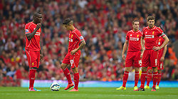 13.09.2014, Anfield, Liverpool, ENG, Premier League, FC Liverpool vs Aston Villa, 4. Runde, im Bild Liverpool's Mario Balotelli looks dejected as Aston Villa score the opening goal // during the English Premier League 4th round match between Liverpool FC and Aston Villa at the Anfield in Liverpool, Great Britain on 2014/09/13. EXPA Pictures &copy; 2014, PhotoCredit: EXPA/ Propagandaphoto/ David Rawcliffe<br /> <br /> *****ATTENTION - OUT of ENG, GBR*****