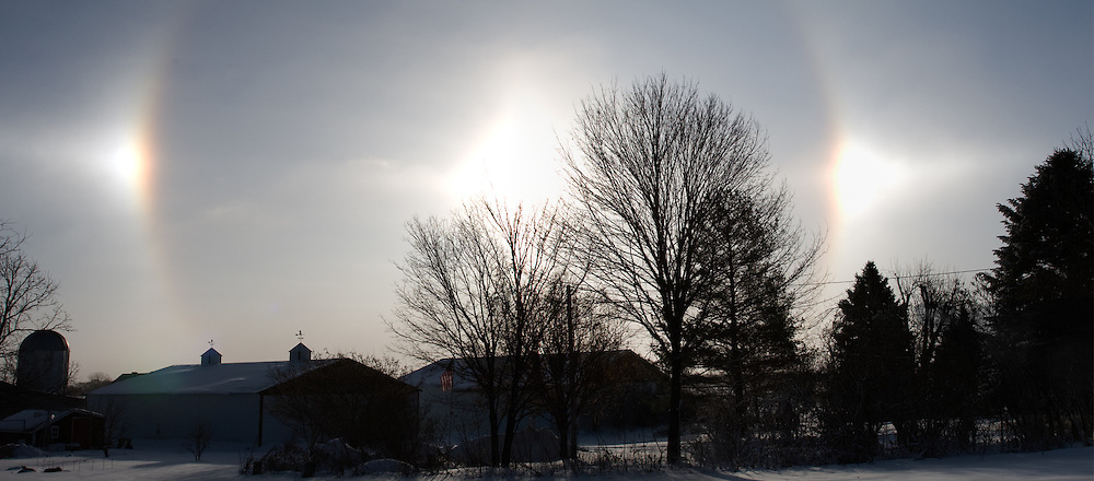 Sun dogs over rural property in winter