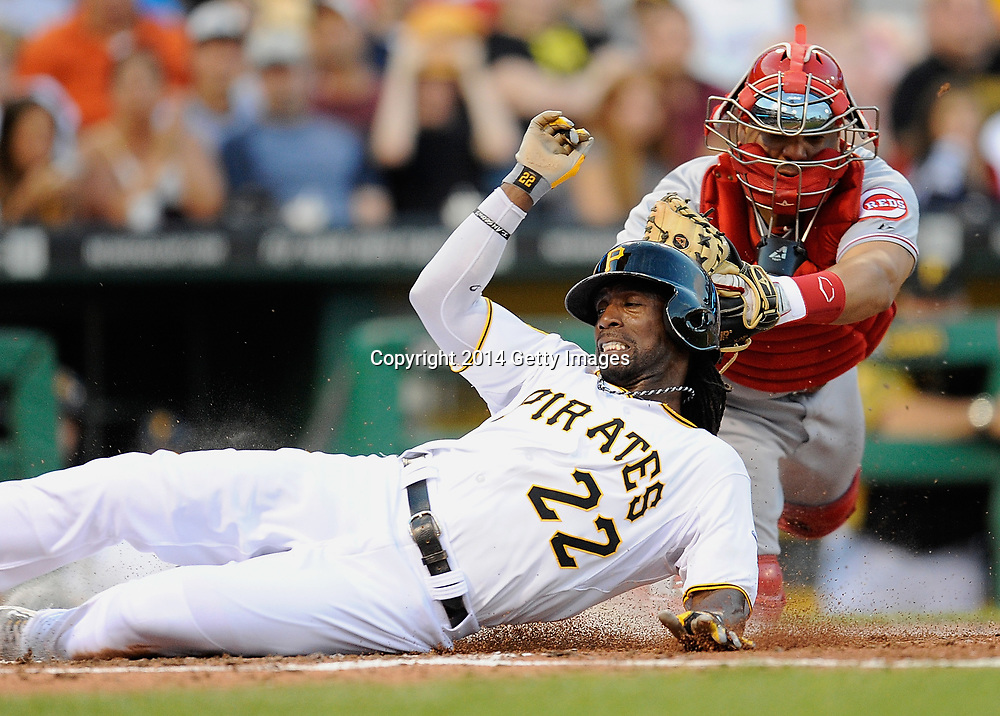 PITTSBURGH, PA - JUNE 17:  Andrew McCutchen #22 of the Pittsburgh Pirates is tagged out by Brayan Pena #29 of the Cincinnati Reds during the third inning on June 17, 2014 at PNC Park in Pittsburgh, Pennsylvania.  (Photo by Joe Sargent/Getty Images) *** Local Caption ***Andrew McCutchen;Brayan Pena