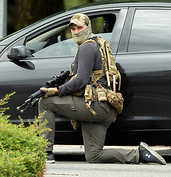 March 15, 2019 - Christchurch, Canterbury, New Zealand - AOS (Armed Offenders Squad) tactical police officer secures the area following a shooting resulting in multiple fatalities and injuries at the Masjid Al Noor Mosque, Deans Avenue, Christchurch, New Zealand. At least 49 people were killed and 20 seriously injured in mass shootings at two mosques in the New Zealand city of Christchurch. 48 people, including young children with gunshot wounds, were taken to hospital. Three people were arrested in connection with the shootings. (Credit Image: © Martin Hunter/SNPA via ZUMA Wire)
