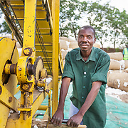 CAPTION: A man works the conveyor belt that takes sacks of raw cotton, as received from the market, to a truck or trailer for weighing and then into the ginnery for processing. LOCATION: Great Lakes Ginnery, Mgabu, Chikwawa, Malawi. INDIVIDUAL(S) PHOTOGRAPHED: Unknown.
