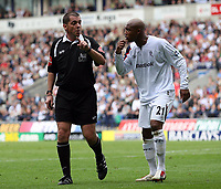 Photo: Paul Thomas.<br /> Bolton Wanderers v Liverpool. The Barclays Premiership. 30/09/2006.<br /> <br /> Referee Mr P Dowd (L) talks to El Hadji Diouf of Bolton.