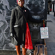 A Christian preaching without mask at street during Coronavirus - Pandemic hit Oxford Street many shops closure a few open but empty on 21 March 2020, UK.