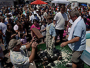 ST GEORGE, SC - APRIL 18: Lance Brownley (C) is weighed after rolling around in a giant vat of grits April 18, 2009 during the World Grits Festival in St. George, SC. Lance won his age group having gathered 17-pounds of grits on his body.     (Photo Richard Ellis)