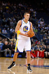 Jan 25, 2012; Oakland, CA, USA; Golden State Warriors center Andris Biedrins (15) holds the ball against the Portland Trail Blazers during the first quarter at Oracle Arena. Golden State defeated Portland 101-93. Mandatory Credit: Jason O. Watson-US PRESSWIRE