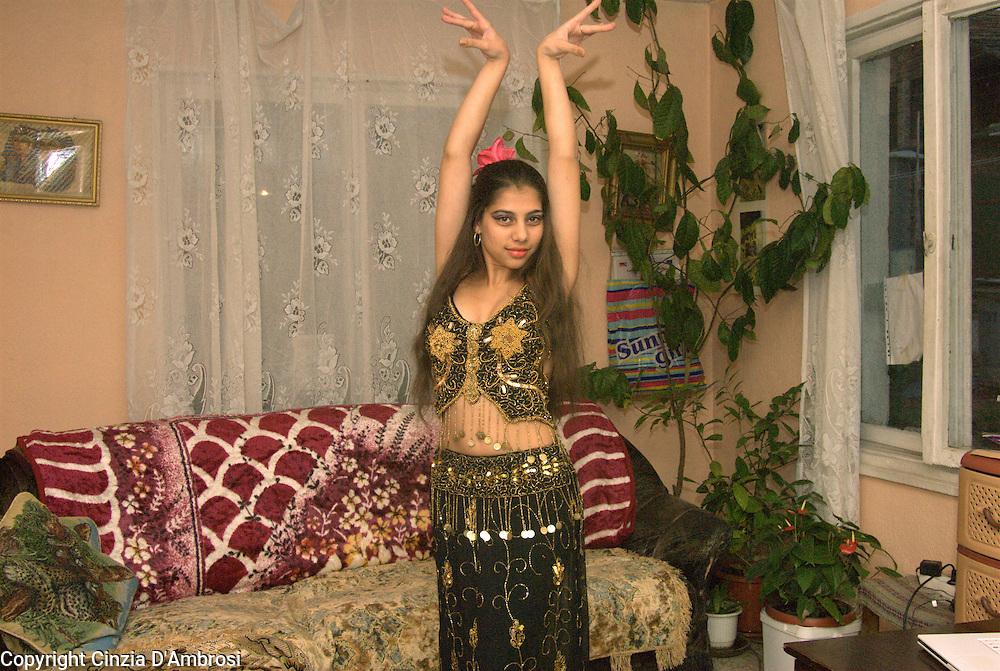 Sali Tasheva, roma gypsy teenager dancing in her home in the ghetto of Fakulteta in Sofia, Bulgaria.