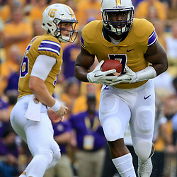 Sep 17, 2016; Baton Rouge, LA, USA;  LSU Tigers running back Leonard Fournette (7) runs against the Mississippi State Bulldogs during the first quarter of a game at Tiger Stadium. Mandatory Credit: Derick E. Hingle-USA TODAY Sports