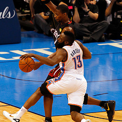Jun 14, 2012; Oklahoma City, OK, USA;  Oklahoma City Thunder guard James Harden (13) drives against Miami Heat power forward Chris Bosh (1) during the first quarter of game two in the 2012 NBA Finals at Chesapeake Energy Arena. Mandatory Credit: Derick E. Hingle-US PRESSWIRE