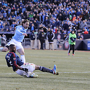 Ned Grabavoy, (left), NYCFC, shoots past Andrew Farrell, New England Revolution, during the New York City FC v New England Revolution, inaugural MSL football match at Yankee Stadium, The Bronx, New York,  USA. 15th March 2015. Photo Tim Clayton