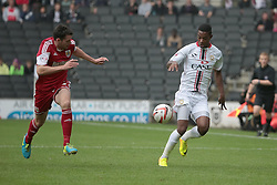 Milton Keynes Dons' Jason Banton is shadowed by Bristol City's Brendan Moloney  - Photo mandatory by-line: Nigel Pitts-Drake/JMP - Tel: Mobile: 07966 386802 24/08/2013 - SPORT - FOOTBALL - Stadium MK - Milton Keynes - Milton Keynes Dons V Bristol City - Sky Bet League One