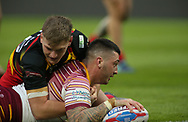 Oliver Roberts of Huddersfield Giants scores the against Dewsbury Rams during the Pre-season Friendly match at the John Smiths Stadium, Huddersfield<br /> Picture by Stephen Gaunt/Focus Images Ltd +447904 833202<br /> 14/01/2018