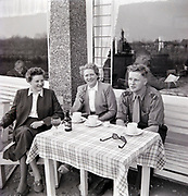sitting at a cafe drinking a coffee outdoors Holland 1950s