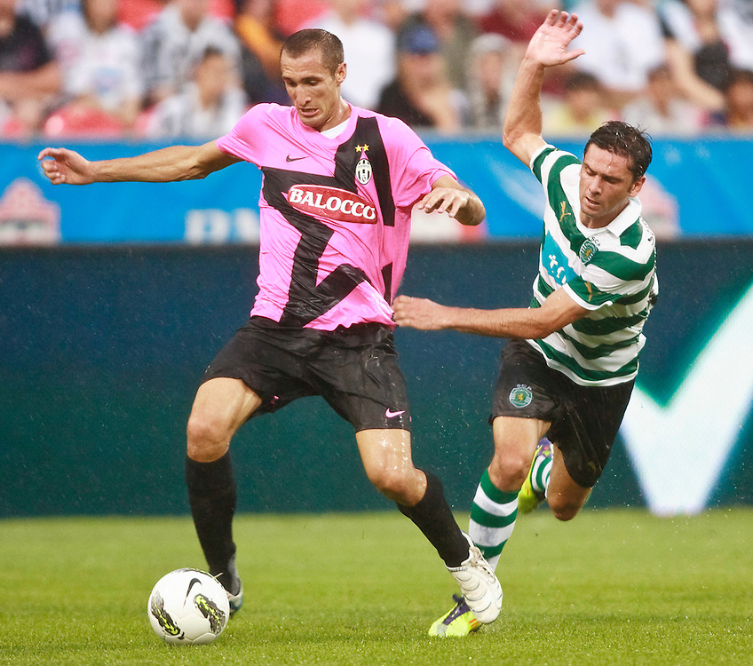 -20110723- Toronto, Ontario,Canada--<br /> Juventus F.C.'s Giorgio Chiellini is pressured by Sporting Clube de Portugal's Helder Postiga in a friendly, part of the Herbalife World Football Challenge, at BMO field in Toronto, Ontario, July 23, 2011.<br /> AFP PHOTO/Geoff Robins