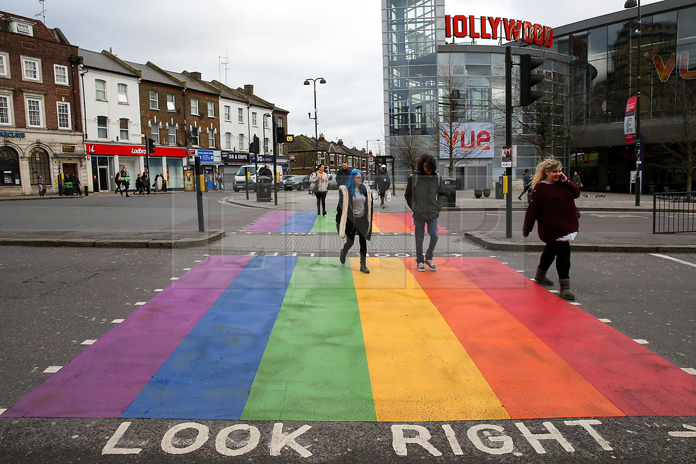 © Licensed to London News Pictures. 17/02/2020. London, UK. Members of public crossing at a second LGBT (Lesbian, gay, bisexual, transgender) rainbow-coloured crossing that has been installed in Haringey, north London in celebration of LGBT History Month. This comes after a rainbow coloured crossing was installed early this month outside a school in Haringey which has received around 200 abusive messages on social media for the installation. Photo credit: Dinendra Haria/LNP