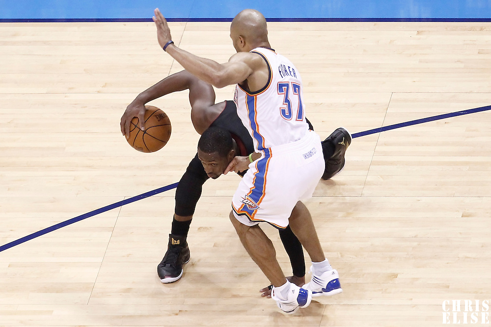 14 June 2012: Oklahoma City Thunder point guard Derek Fisher (37) defends on Miami Heat shooting guard Dwyane Wade (3) during the Miami Heat 100-96 victory over the Oklahoma City Thunder, in Game 2 of the 2012 NBA Finals, at the Chesapeake Energy Arena, Oklahoma City, Oklahoma, USA.