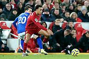 Liverpool defender Trent Alexander-Arnold (66) skips past Everton midfielder Bernard (20)  during the Premier League match between Liverpool and Everton at Anfield, Liverpool, England on 4 December 2019.