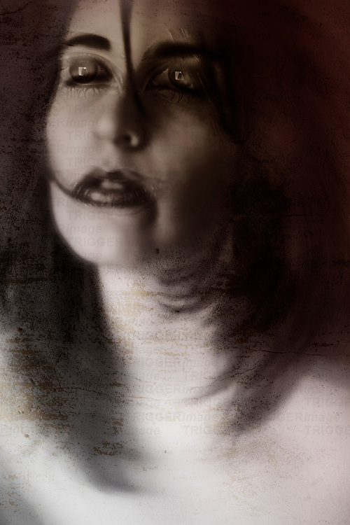 Layered portrait of a female face portraying duality of character.
