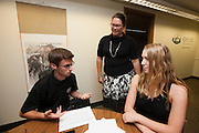 Joshua Bay, Catherine Penrod, and Holly Thobe work in the Center for Professional Communication in Copeland Hall on Thursday, August 27, 2015. Photo by Kaitlin Owens