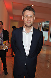 RICHARD BACON at a dinner in aid The Journalism Foundation held at Philips De Pury & Company, Howick Place, London, SW1 on 22nd May 2012.