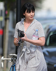 (EXCLUSIVE PICTURES) Model Daisy Lowe nearly has a Marilyn Monroe moment as she steps out of her Mercedes-Benz G-Class AMG. Daisy wearing a white polka-dot dress and pair of black boots lets her boyfriend Cameron McMeikan carry two large boxes from Habitat they arrive home after shopping trip... London, UK. 18/04/2019<br /> BYLINE MUST READ : JAMESY/GOTCHA IMAGES<br /> <br /> Copyright by © Gotcha Images Ltd. All rights reserved.<br /> Usage of this image is conditional upon the acceptance <br /> of Gotcha Images Ltd, terms and conditions available at<br /> www.gotchaimages.com