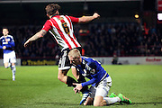 Cardiff City striker, Lex Immers (27) grabbing legs of Brentford defender, Harlee Dean (6) during the Sky Bet Championship match between Brentford and Cardiff City at Griffin Park, London, England on 19 April 2016. Photo by Matthew Redman.
