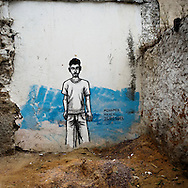 Medina- Tunis.A graffiti on a wall of Medina's district, showing Mohamed Hanchi a young man that was killed on the 25th of March during a protest against Ben Ali regime.