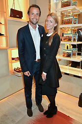 CHARLIE & ANNEKE GILKES at the Roger Vivier 'The Perfect Pair' Frieze cocktail party celebrating Ambra Medda & 'Miss Viv' at the Roger Vivier Boutique, Sloane Street, London on 15th October 2014.