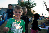 Lathan Goumas for the Midland Daily News..Landen Bainbridge, 5, of Auburn, plays with a sparkler while waiting for the start of the final day of the 50th Bay City Fireworks Festival on Saturday, July 7, 2012 in Bay City, Mich. In celebration the festival planned to fire off 50,000 fireworks in 50 minutes on the final day of the three day event.
