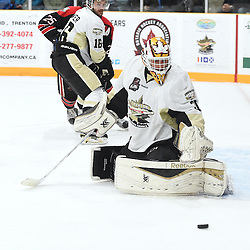 TRENTON, ON - Apr 18, 2016 -  Ontario Junior Hockey League game action between the against the Trenton Golden Hawks and the Georgetown Raiders. Game 3 of the Buckland Cup Championship Series, at the Duncan Memorial Gardens in Trenton, Ontario. Daniel Urbani #30 of the Trenton Golden Hawks protects the crease during the first period.<br /> (Photo by Andy Corneau / OJHL Images)