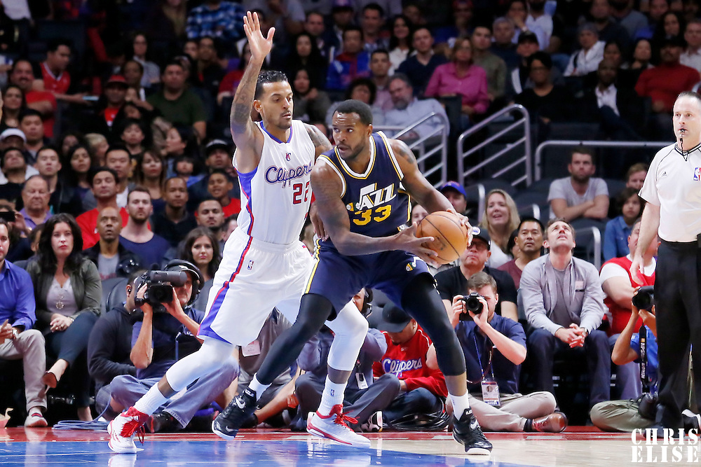 17 October 2014: Los Angeles Clippers forward Matt Barnes (22) defends on Utah Jazz forward Trevor Booker (33) during the Los Angeles Clippers 101-97 victory over the Utah Jazz, in a preseason game, at the Staples Center, Los Angeles, California, USA.
