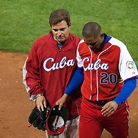 16 March 2009: Cuban team doctor Antonio Castro helps #20 Norge Luis Vera of Cuba off the field after injuring his leg while pitching during the 2009 World Baseball Classic Pool 1 game 3 at Petco Park in San Diego, California, USA. Cuba wins 7-4 over Mexico.