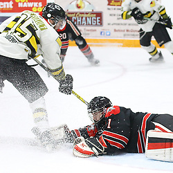 """TRENTON, ON  - MAY 5,  2017: Canadian Junior Hockey League, Central Canadian Jr. """"A"""" Championship. The Dudley Hewitt Cup Game 7 between Georgetown Raiders and the Powassan Voodoos.    Ryan Theriault #15 of the Powassan Voodoos tries to get the puck as Josh Astorino #1 of the Georgetown Raiders dives to make the stop during the first period<br /> (Photo by Alex D'Addese / OJHL Images)"""