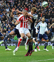 Stoke City's Jonathan Walters is caught in the face, by the elbow of  West Bromwich Albion's Craig Dawson - Photo mandatory by-line: Dougie Allward/JMP - Mobile: 07966 386802 - 14/03/2015 - SPORT - Football - Birmingham - The Hawthorns - West Bromwich Albion v Stoke City - Barclays Premier League