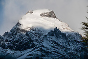 """Snow-dusted, glacier-clad Cerro Solo. We hiked 21 km (13 miles) round trip with 730 m (2400 ft) cumulative gain to Laguna Torre and Mirador Maestri to see Cerro Torre and other peaks. El Chalten mountain resort is in Santa Cruz Province, Argentina, Patagonia, South America. The village is settled on the riverside of Rio de las Vueltas, within Los Glaciares National Park near the base of Cerro Fitz Roy (3405 m or 11,171 ft elevation), at the edge of the Southern Patagonian Ice Field. The town is 220 km north of El Calafate. Chaltén comes from a Tehuelche word meaning """"smoking mountain"""", due to clouds that usually form over Monte Fitz Roy."""