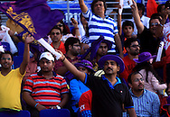 A fan of Kokatta Knight Riders waves a flag during match 15 of the Pepsi Indian Premier League 2014 Season between The Kings XI Punjab and the Kolkata Knight Riders held at the Sheikh Zayed Stadium, Abu Dhabi, United Arab Emirates on the 26th April 2014<br /> <br /> Photo by Sandeep Shetty / IPL / SPORTZPICS