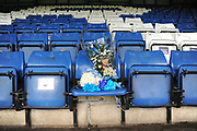 Flowers in the seat of Lifelong Bury Fan, Ian Doody, who passed away during the last home game beofore the EFL Sky Bet League 2 match between Bury and Mansfield Town at the JD Stadium, Bury, England on 6 October 2018.