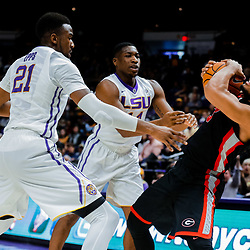 Jan 16, 2018; Baton Rouge, LA, USA; Georgia Bulldogs guard Juwan Parker (3) is pressured by LSU Tigers forward Aaron Epps (21) and guard Randy Onwuasor (14) during the second half at the Pete Maravich Assembly Center. Georgia defeated LSU 61-60. Mandatory Credit: Derick E. Hingle-USA TODAY Sports