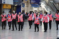 © Licensed to London News Pictures. 15/06/2020. London, UK. Extra staff in pink high visability vests arrive at Waterloo Station to help with distancing measures. New rules allowing some non-essential retail businneses to open and mandatory face masks on public transport have started today. Photo credit: Peter Macdiarmid/LNP