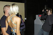 Model hopefuls have their picture taken at a model search competition at Edwards Club in Cardiff. Photograph: Rob watkins 9/2002