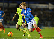 Portsmouth defender Adam Webster beats Hartlepool United Striker Rakish Bingham to the ball during the Sky Bet League 2 match between Portsmouth and Hartlepool United at Fratton Park, Portsmouth, England on 12 December 2015. Photo by Adam Rivers.