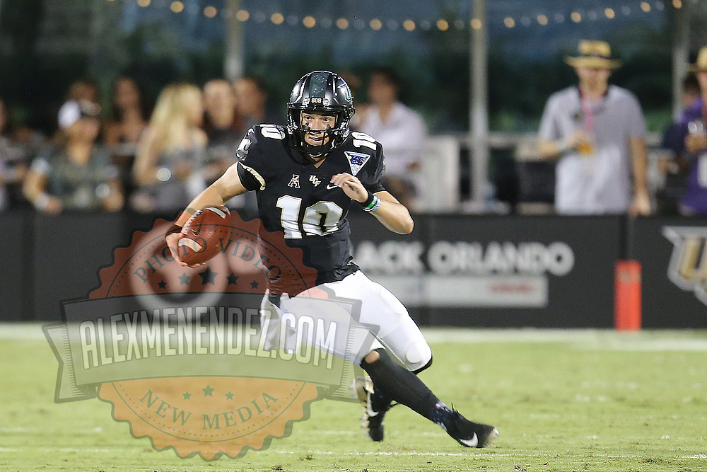 ORLANDO, FL - OCTOBER 14: McKenzie Milton #10 of the UCF Knights runs with the ball during a NCAA football game between the East Carolina Pirates and the UCF Knights at Spectrum Stadium on October 14, 2017 in Orlando, Florida. (Photo by Alex Menendez/Getty Images)