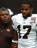 MORNING JOURNAL/DAVID RICHARD.Cleveland head coach Romeo Crennel, left, has words for Browns receiver Braylon Edwards yesterday against New Orleans.