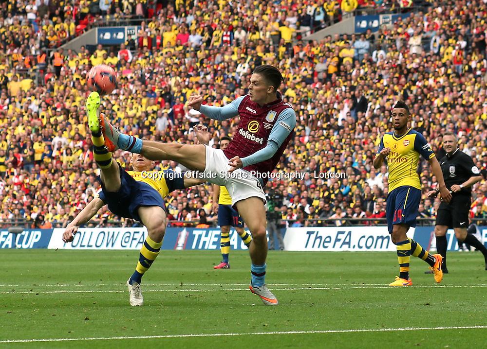 30 May 2015 FA Cup Final - Arsenal v Aston Villa ;  Jack Grealish of Villa is beaten to the ball by Laurent Koscielny.<br /> Photo: Mark Leech.